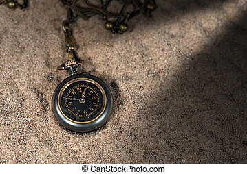 Small Pocket Watch over the Sand