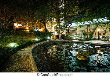 Small pond and modern buildings at night, from Hong Kong University, in Hong Kong, Hong Kong.