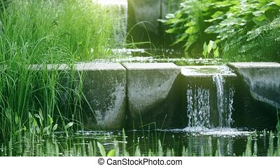 Small pond and waterfall in the park, shot on Red camera -...