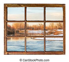 small prairie river in winter scenery