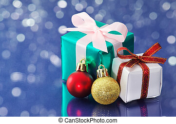Small presents on blue sparkle background.
