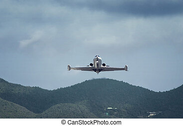small private business jet is landing