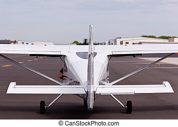 Small private plane from rear