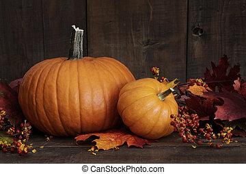 Small pumpkins on wood table