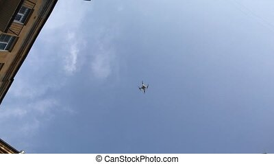 Small quadcopter droneflying at sunny day. Blue sky