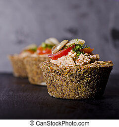 vegan raw food quiche with nut filling and vegetables on top