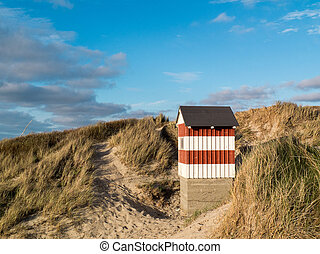 Small red and white striped hut