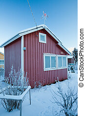 Small red cabin at winter