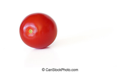 Small red cherry tomato isolated on white background, space for text right side
