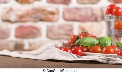 Small red cherry tomatoes on rustic background. Cherry...
