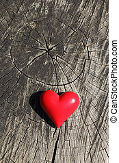 Small red heart on a wooden background