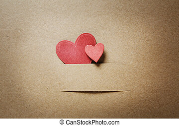 Small red paper cut hearts