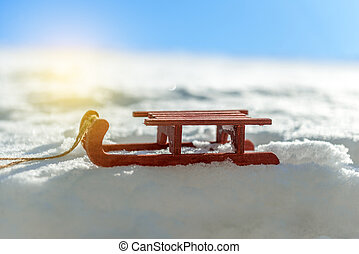 small red sled in the snow