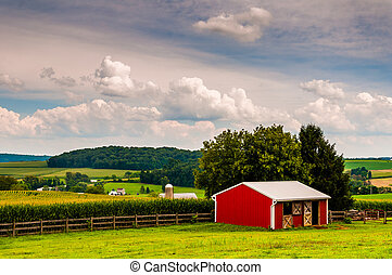Small red stable and view of farms in Southern York County, Pennsylvania.