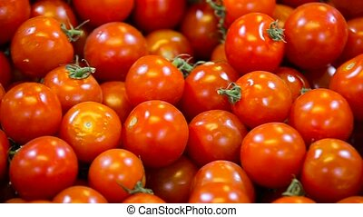 small ripe tomatoes close up