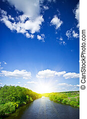Small river and sun in the blue sky. - Nice view of ...