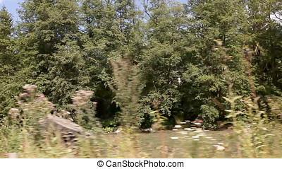 Small River Mountain Landscape Vehicle Shot - Small river...