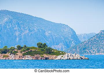 small rocky island in the Aegean Sea