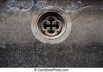 Small round window in wall