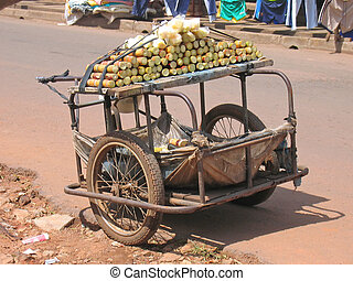 Small rural car with two wheels parked in the street to sell sugar cane, Cameroon, Africa