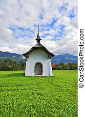 Small rural chapel on a meadow - Small rural chapel on a...
