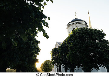 Small russian church in park at sunset