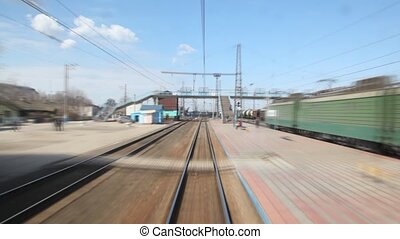 small Russian train station, tracks and cisterns from moving train