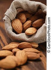 small sack bag full of almonds