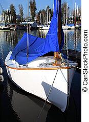 Small sailboat moored.