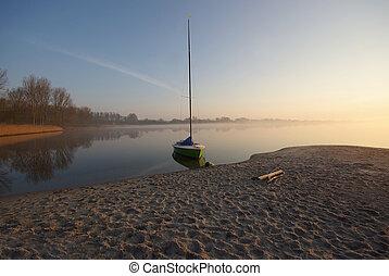 Small Sailing Boat at Sunrise