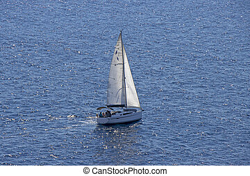 Small Sailing boat yacht in the open blue Sea