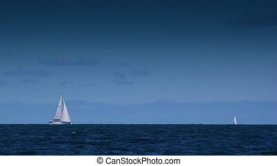 Small Sailing Yacht Boat at Sea