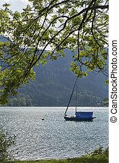 small sailing yacht on Alpine lake Mondsee, Austria
