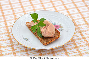 Small sandwich with a cod liver.
