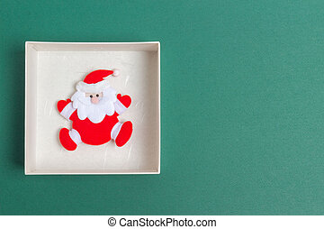 Small Santa Claus in a Christmas Day Gift Box