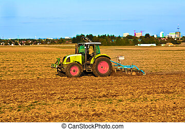 Small scale farming with tractor and plow - Small scale...