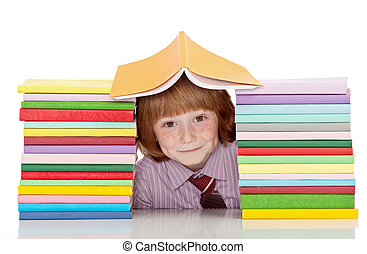 Small school boy with shirt and tie and lots of books