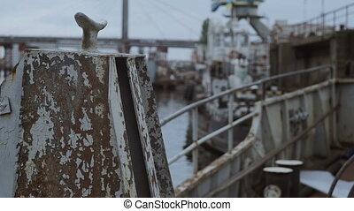Small serving boat in the port, rack focus