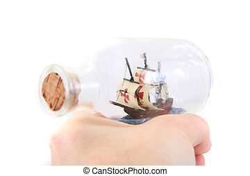 small ship in human hand