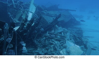 Small shipwreck at the sand bottom