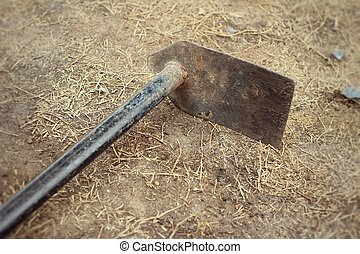Small shovel for gardening on soil background