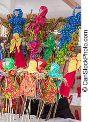 Small Shrovetide dolls on street fair - scarecrow for burning as symbol of spring coming.