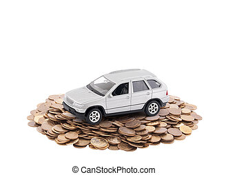 Small silver car on a pile of coins isolated on white background