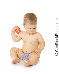Small sitting baby with toy isolated