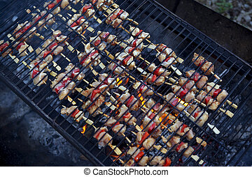 Small skewers on a grill