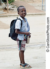 Small smiling schoolboy.