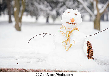 Small snowman in the park close up
