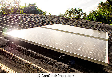 Small Solar panel on roof of house in the countryside