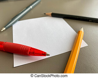 Small square pieces of paper for notes and notes on the office desk and ballpoint pens with pencils. Business work