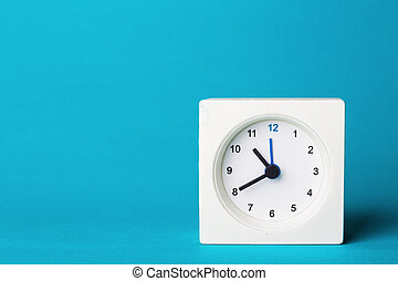 white clock on a blue background